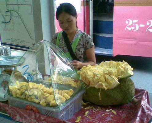 Selling jackfruit in Bangkok.